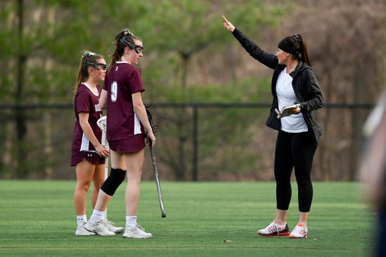 Ridgewood head coach Crysti Foote, right, talks to her players during their win over IHA. No. 1 Ridgewood defeated No. 2 IHA 19-5 on Monday, April 8, 2019, in Washington Township.