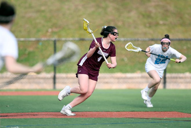 Ridgewood's Sara Ellinghaus runs against IHA defenders in the second half. No. 1 Ridgewood defeated No. 2 IHA 19-5 on Monday, April 8, 2019, in Washington Township.