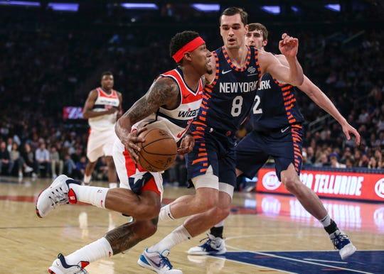 Apr 7, 2019; New York, NY, USA; Washington Wizards guard Bradley Beal (3) drives past New York Knicks forward Mario Hezonja (8) in the first quarter at Madison Square Garden. Mandatory Credit: Wendell Cruz-USA TODAY Sports