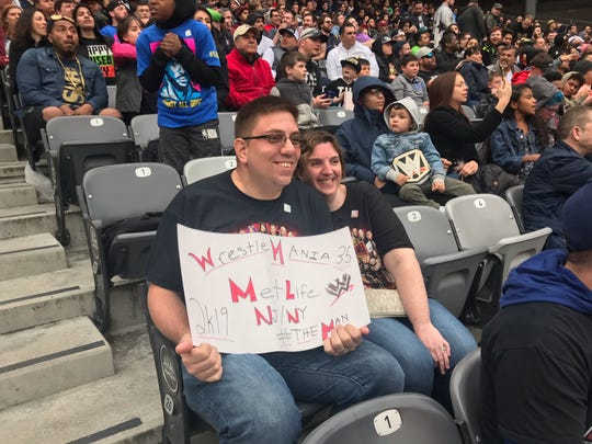 Jack and Erin Pensabene of Middletown watch Wrestlemania 35 from the stands at MetLife Stadium. 4/7/19.