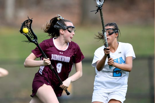 Ridgewood's Annie McCarthy (9) drives with pressure from IHA's Aly Priolo (2) in the first half. No. 1 Ridgewood faces No. 2 IHA on Monday, April 8, 2019, in Washington Township.