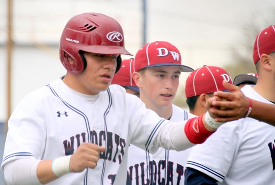 It was fist bumps all-around when senior Wildcat Robert Ruiz touched home plate after lifting a solo home run in game one of the District 3-5A double-header against Onate High.
