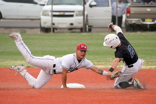 Junior Wildcat short stop Fernie Munoz lunges to apply a tag on Onate base runner Dylan Snyder during Friday's District 3-5A double-header. The Knights took two from the Wildcats, 7-2 and 3-1 at E.J. Hooten Park.