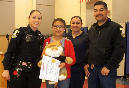 Anna Chairez also won a special award for the top D.A.R.E. essay. She is pictured with, from left, Deming Police officers Ashley Ramos, Britney Pena and assistant chief Alex Valdespino.