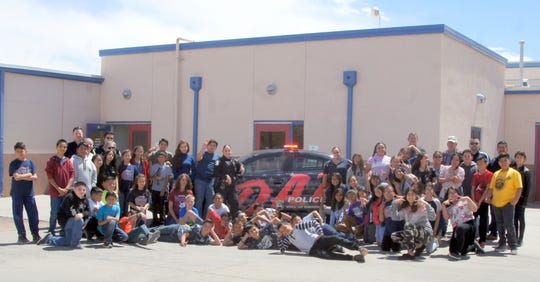 Memorial Elementary School fifth graders pose with the Deming Police Department's D.A.R.E. patrol unit.