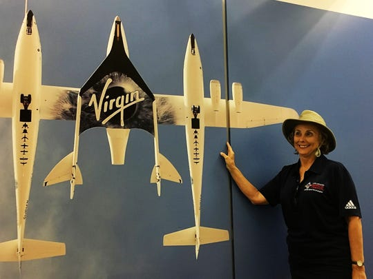 Sally Krusing of Tucson, Arizona, visits a photograph of Virgin Galactic's SpaceShipTwo at Spaceport America in New Mexico on April 7, 2019. Krusing holds a ticket for a future suborbital flight.