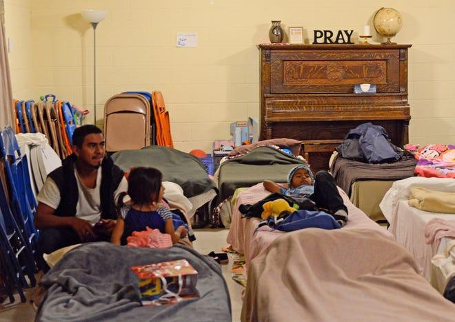 Migrants get ready for bed at El Calvario United Methodist Church.