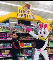 Hopkins the Easter Bunny shows off Easter products with Walmart associate Alexandra Apodaca at the Walmart on 1550 S Valley Dr. Saturday, April 6.