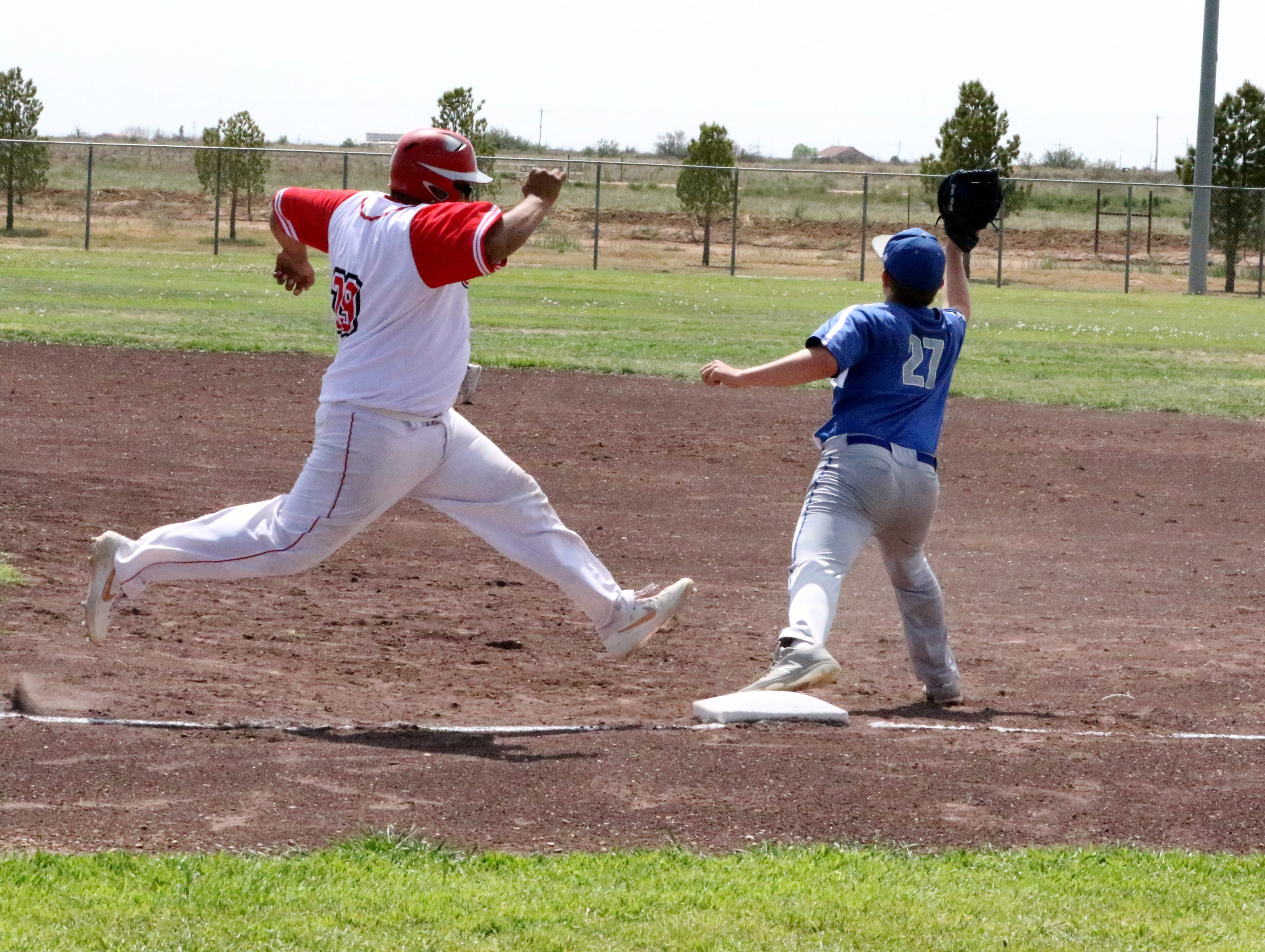 Loving's Mauro Moreno tries to beat out a throw to first base during Saturday's doubleheader against Carlsbad's C team.