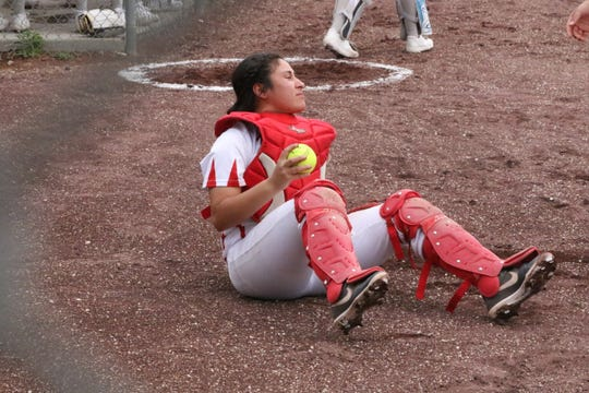 Loving catcher Angellica Villegas holds onto a foul ball for an out the first game of Saturday's doubleheader against Carlsbad.