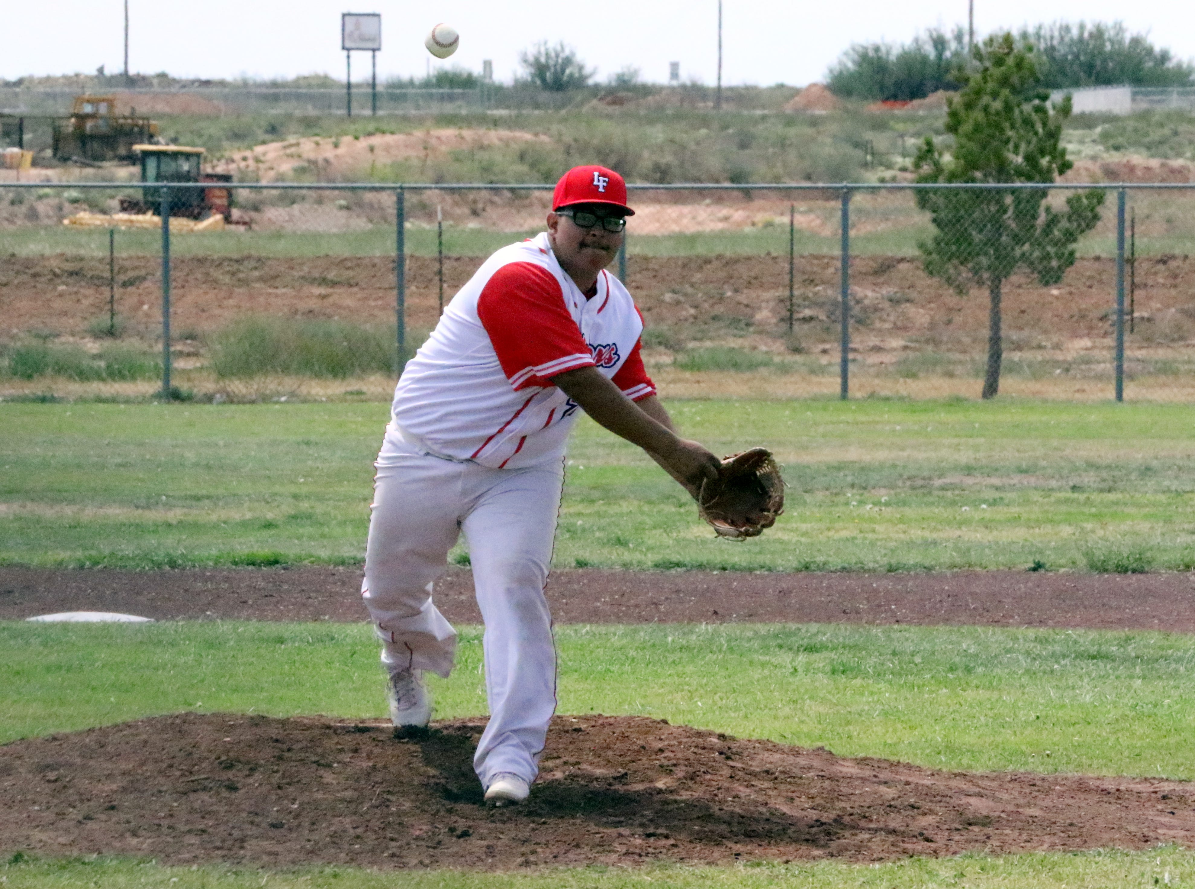 Loving's Mauro Moreno pitches during Saturday's doubleheader against Carlsbad's C team.
