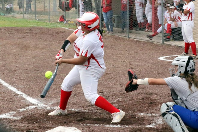 Lorissa Martinez connects with a pitch in the first inning of Saturday's game against the Carlsbad JV team.