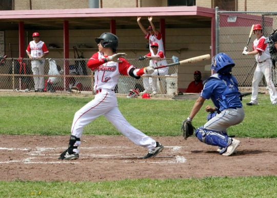 Loving's Gio Martinez swings through a pitch during Saturday's doubleheader against Carlsbad's C team.