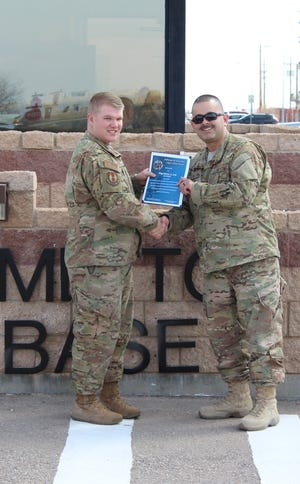 (From right to left) Chief Master Sgt. Manuel Silva, 635th Materiel Maintenance Support Squadron superintendent, presents the Chief's Choice Award to Staff Sgt. Brian Lee, 635th MMSS noncommissioned officer in charge of service support, March 27, 2019, on Holloman Air Force Base, N.M. Holloman's Chiefs Group has a monthly recognition program titled Chief's Choice Award. Every month a chief has the honor of choosing a deserving Airman for an outstanding act or for continuous outstanding performance.