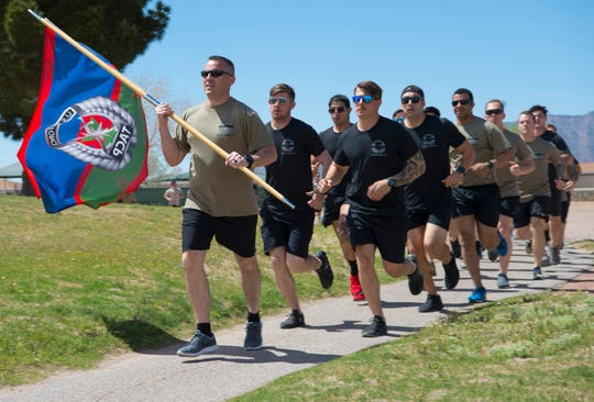 Lt. Col. Nicklaus Walker, 7th Air Support Operations Squadron commander, leads his squadron in the first mile of the 8th Annual Tactical Air Control Party Association run, March 28, 2019, on Fort Bliss, Texas. The 7th ASOS ran the first and last miles of this event together as a squadron. (U.S. Air Force photo by Airman 1st Class Quion Lowe)