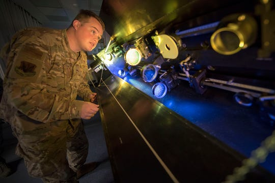 Senior Airman Sidney Johnson, 2d Weather Squadron, Detachment 4, solar analyst, focuses telescope lenses, March 19, 2019, on Holloman Air Force Base, N.M. Analysts are given two minutes to report routine or event solar findings to to geophysical and solar activity forecasters who then push additional findings within six minutes to DoD space weather users, such as Air Force Space Command, Joint Space Operations Center, NORAD, and Joint Force, and in addition, to civilian customers such as NASA and the Federal Aviation Administration.