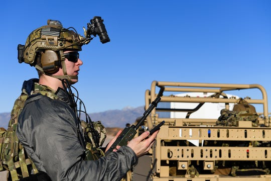 U.S. Air Force 2nd Lt. William, 351st Special Warfare Training Squadron combat rescue officer student, trains with tactical air control party members, assigned to the 7th Air Support Operations Squadron, on calling in close air support and nine lines on Red Rio Range, N.M., March 14, 2019. The CROs and TACPs worked with MQ-9 Reapers from Holloman Air Force Base, to simulate real world scenarios and improve communication with the pilots. Last names have been withheld due to operational security restraints.