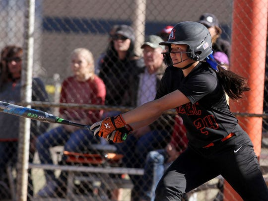 Aztec's Jocelyn Ulrich, seen here during a game against Farmington on March 19, 2016 at Ricketts Softball Complex in Farmington, is hitting .630 this season. Ulrich, who will play softball at NCAA Division I University of New Mexico, has a .517 career batting average with the Lady Tigers.