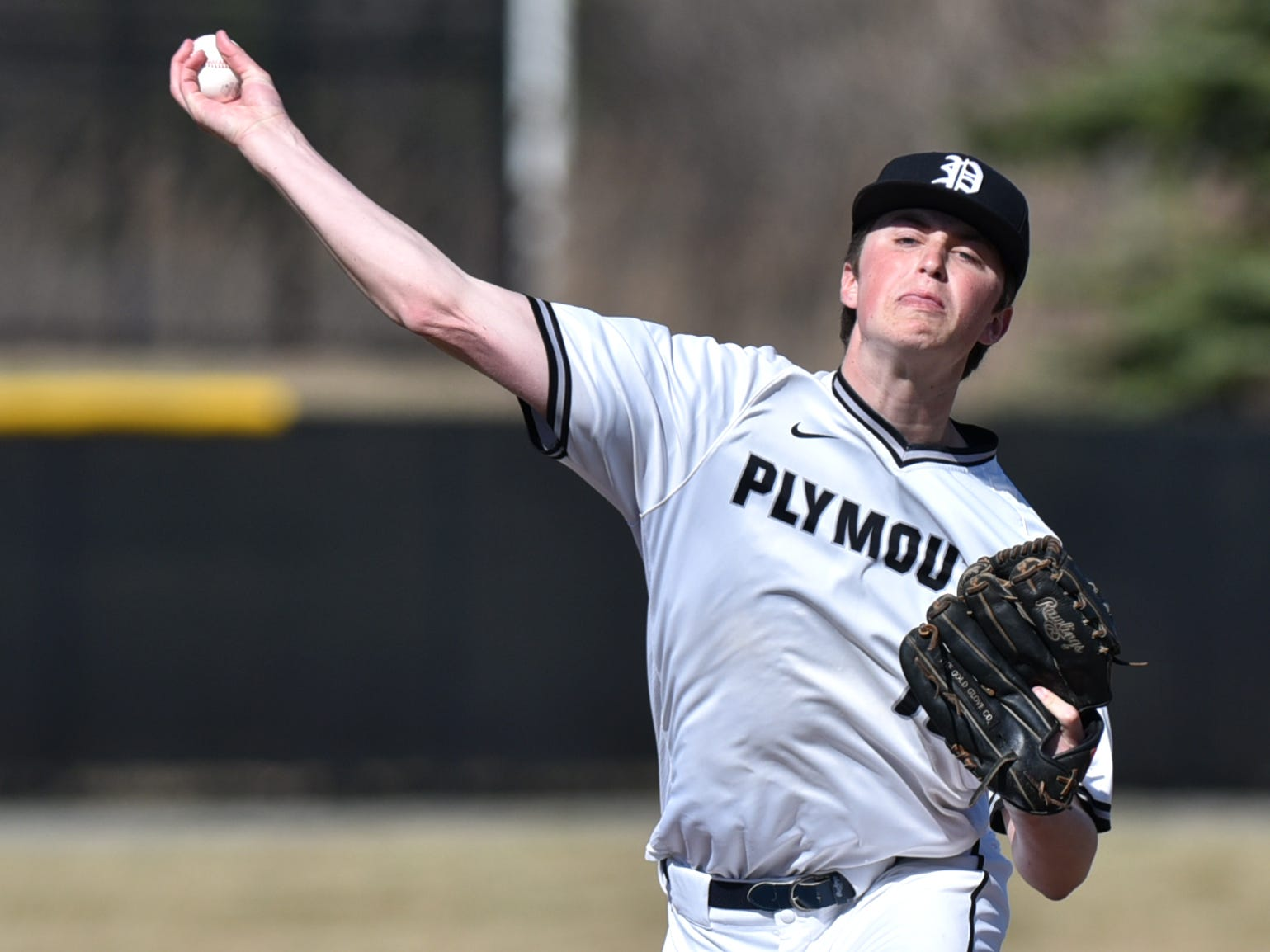 Plymouth Wildcat Dylan Brown pitches to the Northville Mustangs.