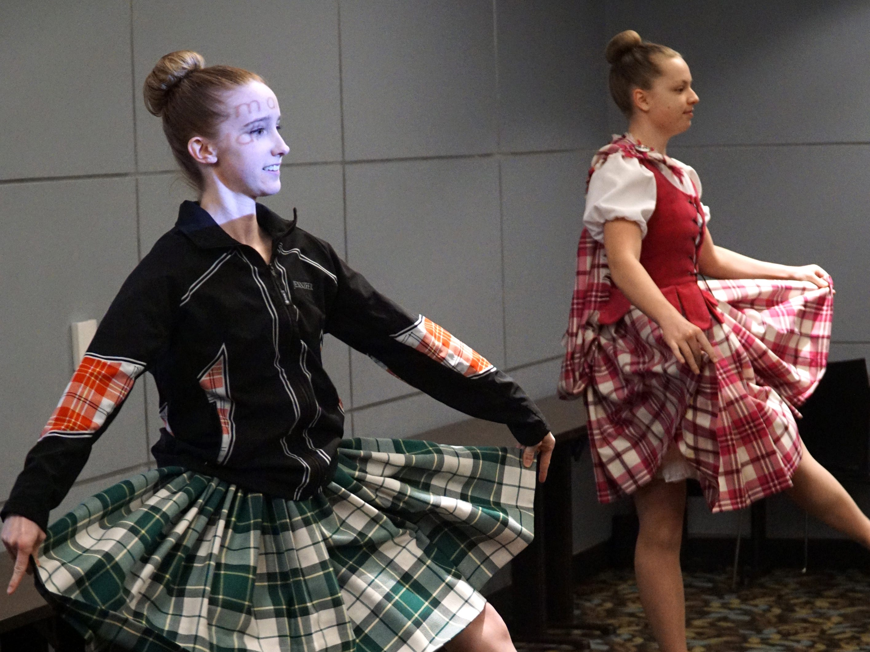 Jennifer Lopez, left, and Adeline Byrne, 15, perform the Flora - a Highland Dance - at the Baldwin Public Library in Birmingham.