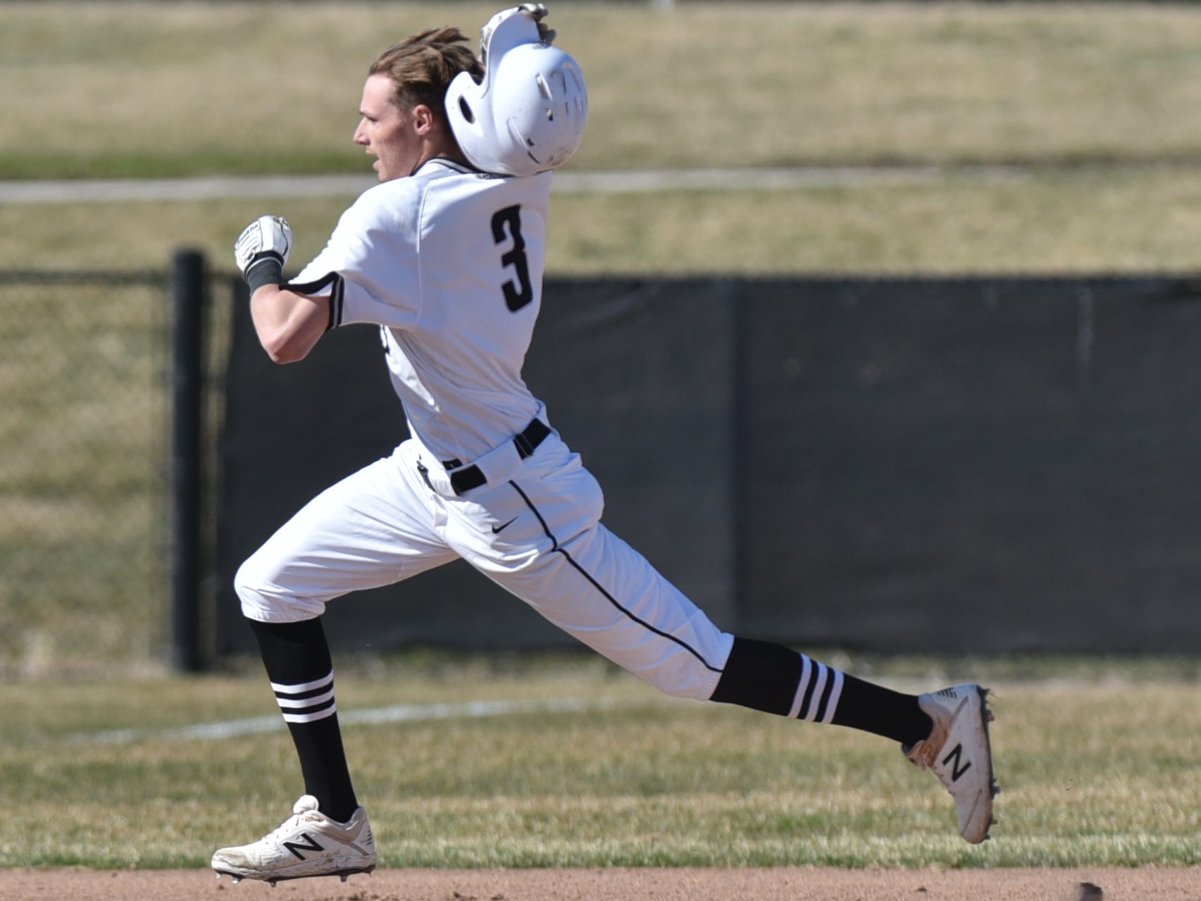 Plymouth's Anthony Sharkas nearly loses his batting helmet as he flies towards third for a triple early in the game. Sharkas came home on a homer by teammate Alec Bashears.