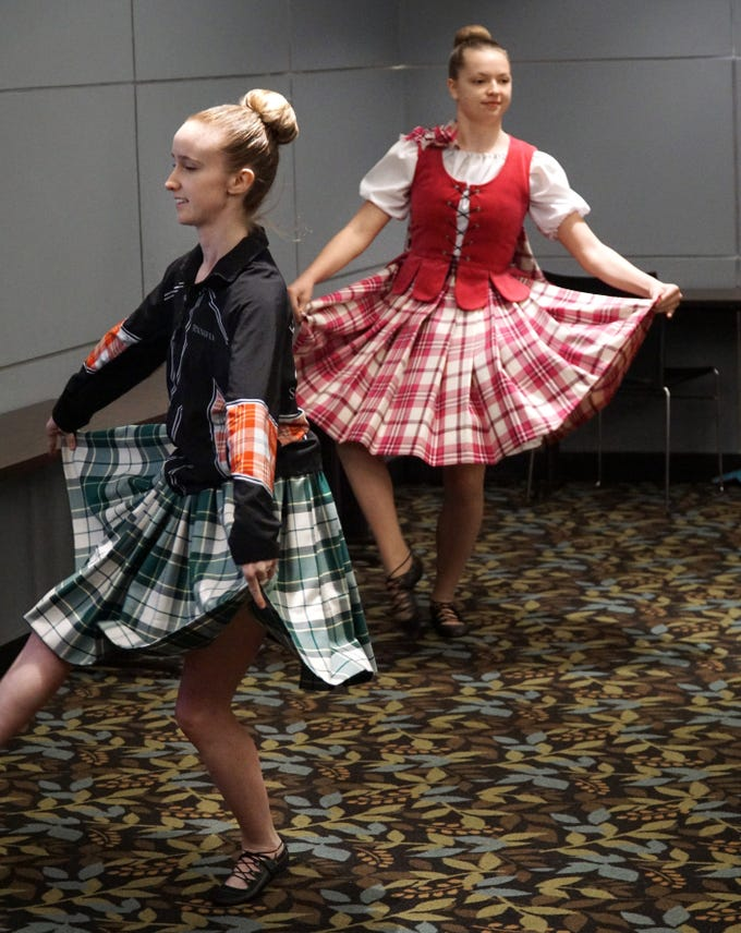 Jennifer Lopez, left, and Adeline Byrne, 15, perform a Highland Dance routine during an April 4 visit to the Birmingham Public Library.