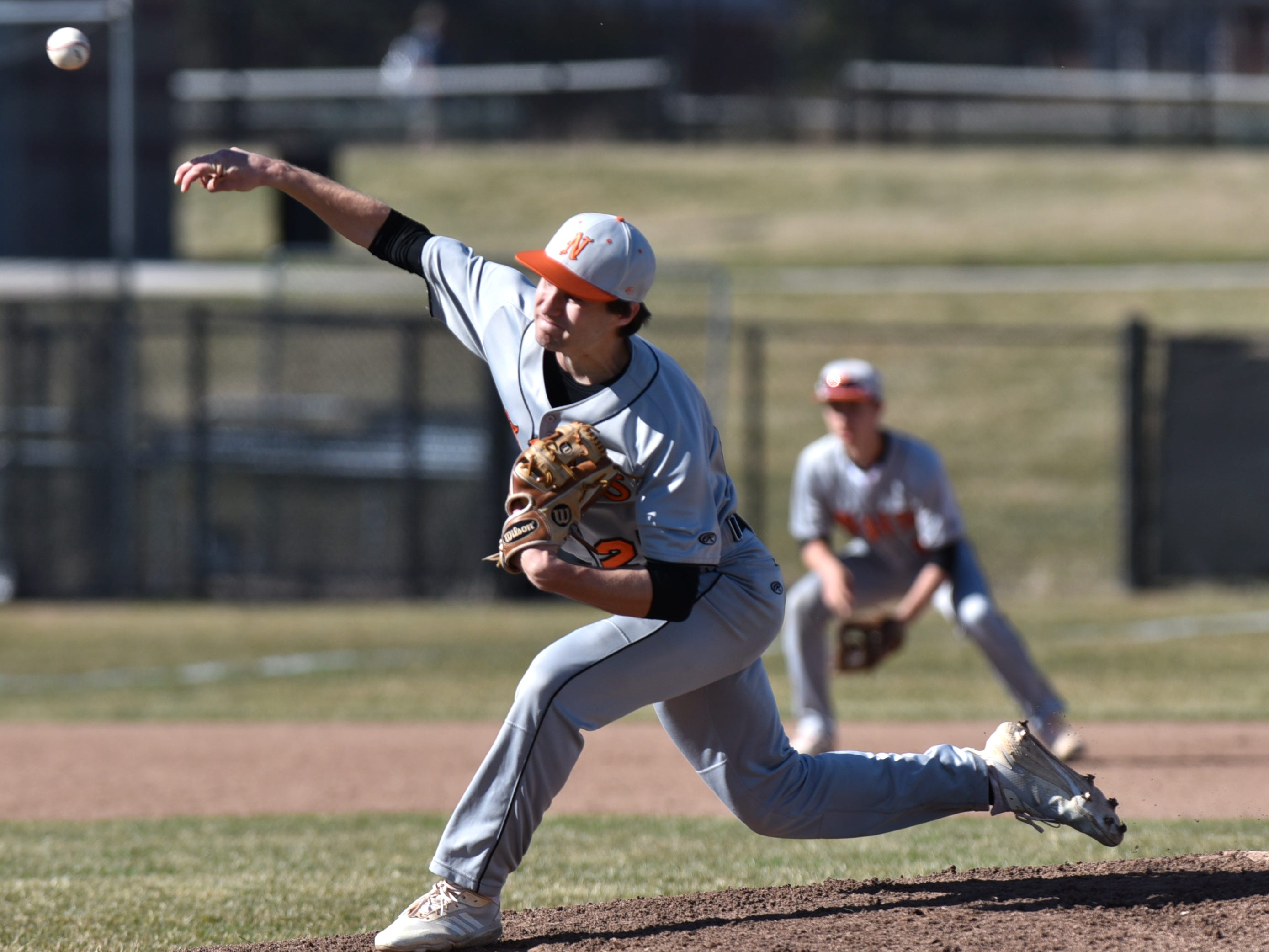 Mustang pitcher Spencer Ziparo fires one to home plate.
