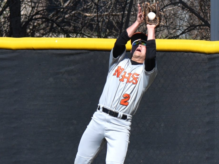 Plymouth drove a lot of ball deep into the Mustang outfield - including this shot caught by outfielder Nick Gattoni.