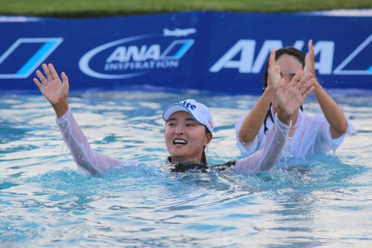 Jin Young Ko jumps into Poppie's Pond after winning the ANA Inspiration, Rancho Mirage, Calif., April 7, 2019.