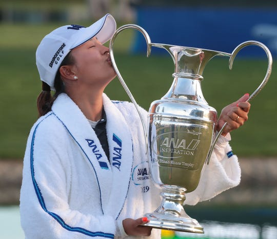 Jin Young Ko kisses the trophy after winning the ANA Inspiration at Mission Hills Country Club in Rancho Mirage, April 7, 2019.