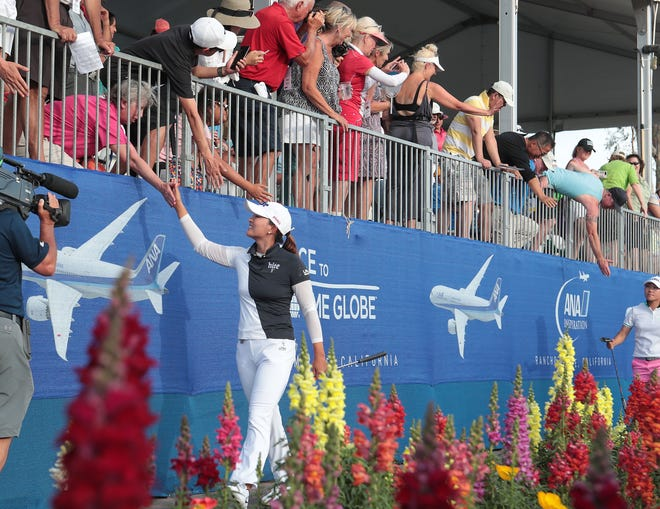 Jin Young Ko high-fives the gallery one her way to the 18th green at the ANA Inspiration at Mission Hills Country Club in Rancho Mirage, April 7, 2019.