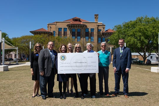 The UWF Foundation received a donation in support of the Larry Butler Memorial Music Award from Peggy Butler at the Museum Plaza in Historic Pensacola on Tuesday, April 2, 2019.