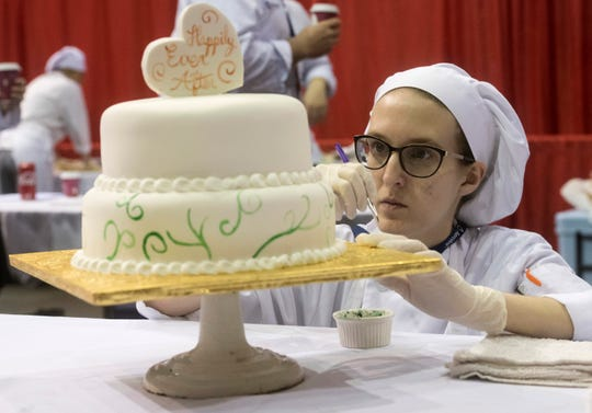 Phoebe Brailer, from the Institute of Culinary Arts at Eastside High School in Gainsville, demonstrates her cake decorating abilities on Monday at the 2019 SkillsUSA Florida State Leadership and Skills Conference at the Pensacola Bay Center.