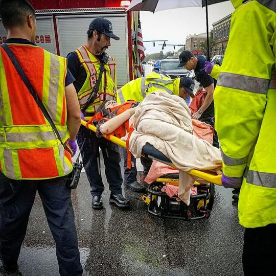 Ashley McGlothren is tended to by emergency responders, after being struck by a vehicle at the intersection of East Main Street and South Jefferson Street on April 5, 2019.