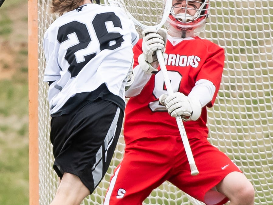 A shot from South Western's Jake Bollinger (26) bounces off Susquehannock's Connor Kernan's stick during a YAIAA lacrosse game in Hanover on Monday, April 8, 2019. Susquehannock won 14-3.