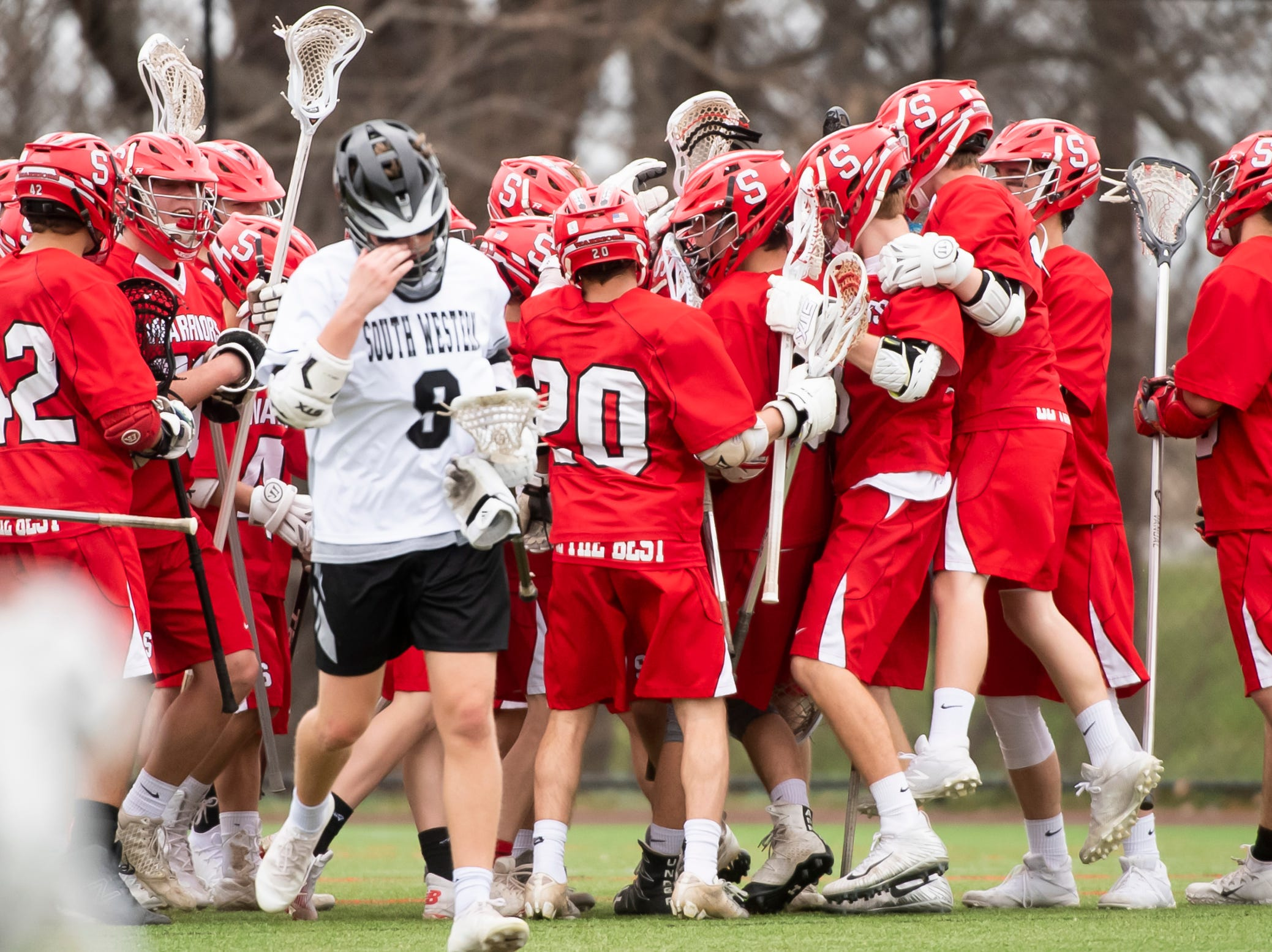 The Susquehannock Warriors celebrate their 14-3 victory over South Western in Hanover on Monday, April 8, 2019.