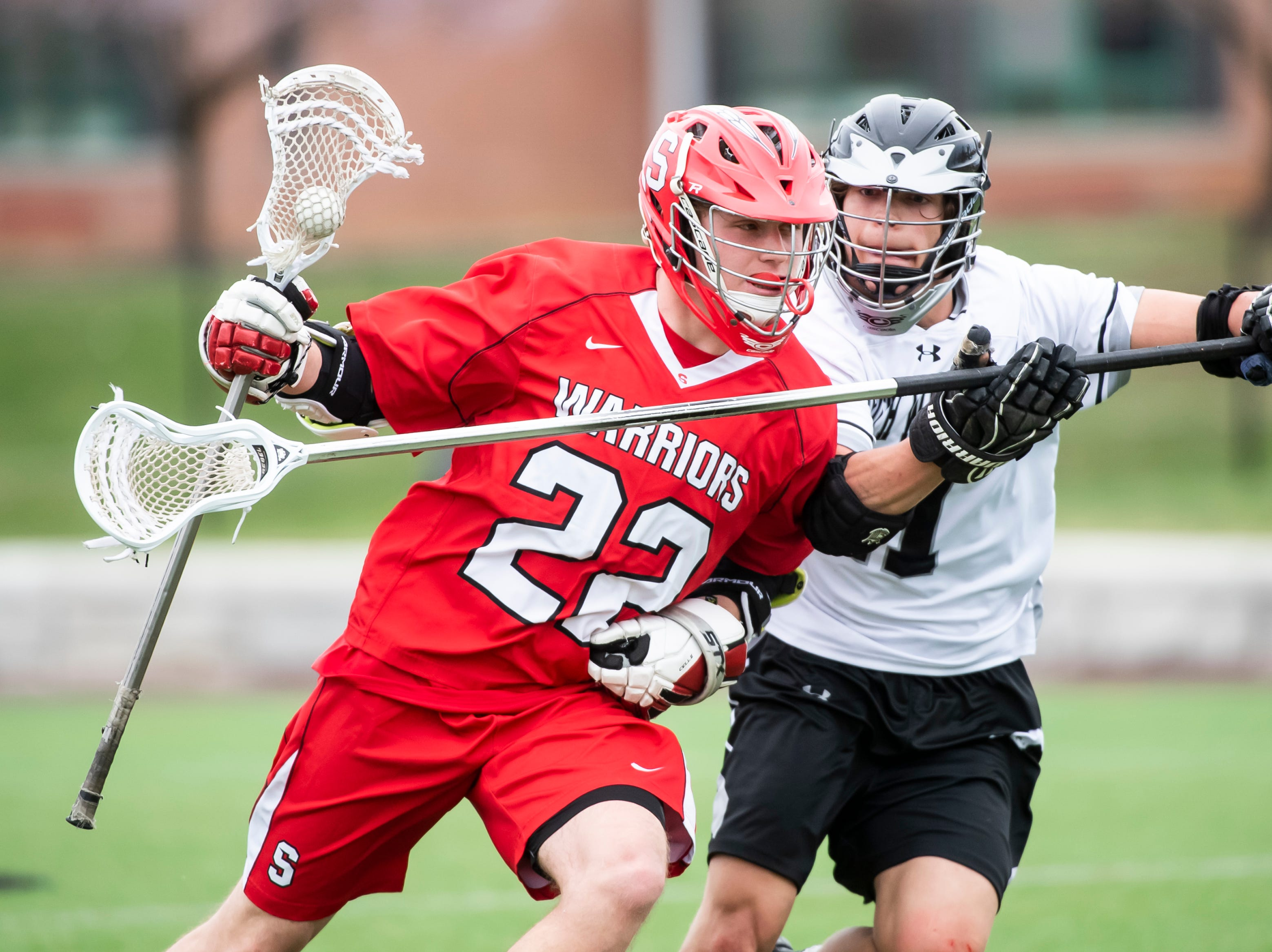 Susquehannock's Allen Clapp (22) gets checked by South Western's Austin Fuhrman during a YAIAA lacrosse game against South Western in Hanover on Monday, April 8, 2019. Susquehannock won 14-3.