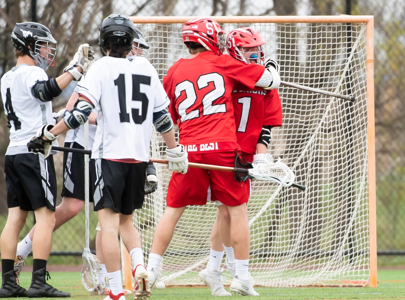 Susquehannock's Ben Tomasic (1) celebrates with Allen Clapp (22) after scoring a goal during a YAIAA lacrosse game against South Western in Hanover on Monday, April 8, 2019. Susquehannock won 14-3.