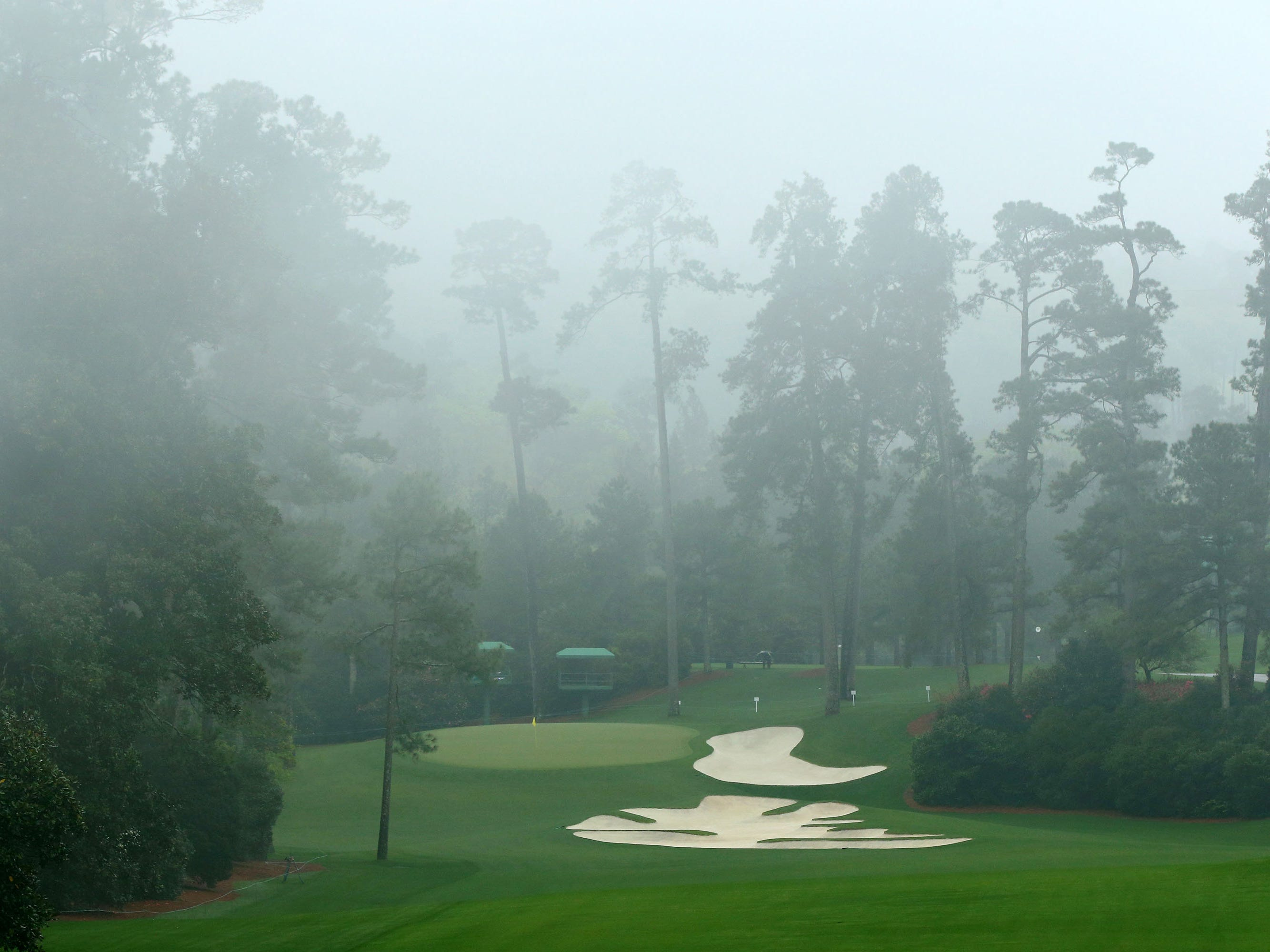 Apr 7, 2019; Augusta, GA, USA; Pine trees and fog on the 10th hole at Augusta National Golf Club. Mandatory Credit: Rob Schumacher-USA TODAY Sports
