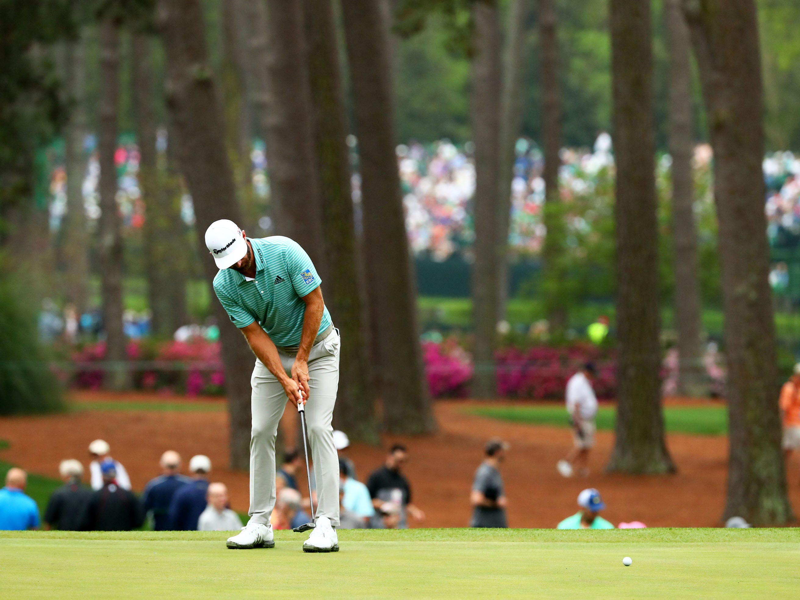 Apr 8, 2019; Augusta, GA, USA; Dustin Johnson putts on the third green during a practice round for the Masters golf tournament at Augusta National Golf Club.