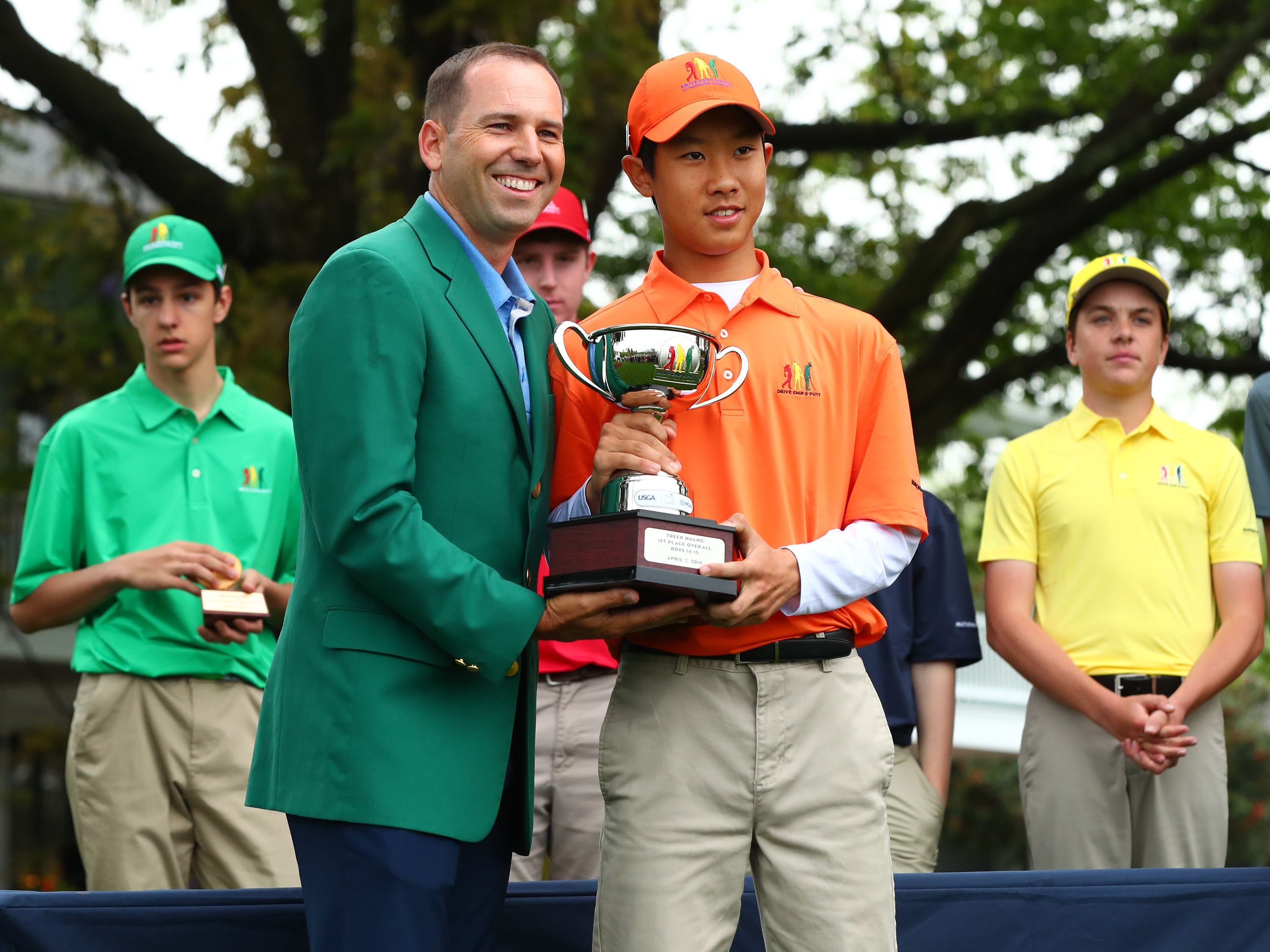 Apr 7, 2019; Augusta, GA, USA; Masters champion Sergio Garcia poses with overall champion Treed Huang of Katy, TexasÊfor the boys 14-15 age group, hits his putt during the finals of the Drive, Chip and Putt competition at Augusta National Golf Club. Mandatory Credit: Rob Schumacher-USA TODAY Sports