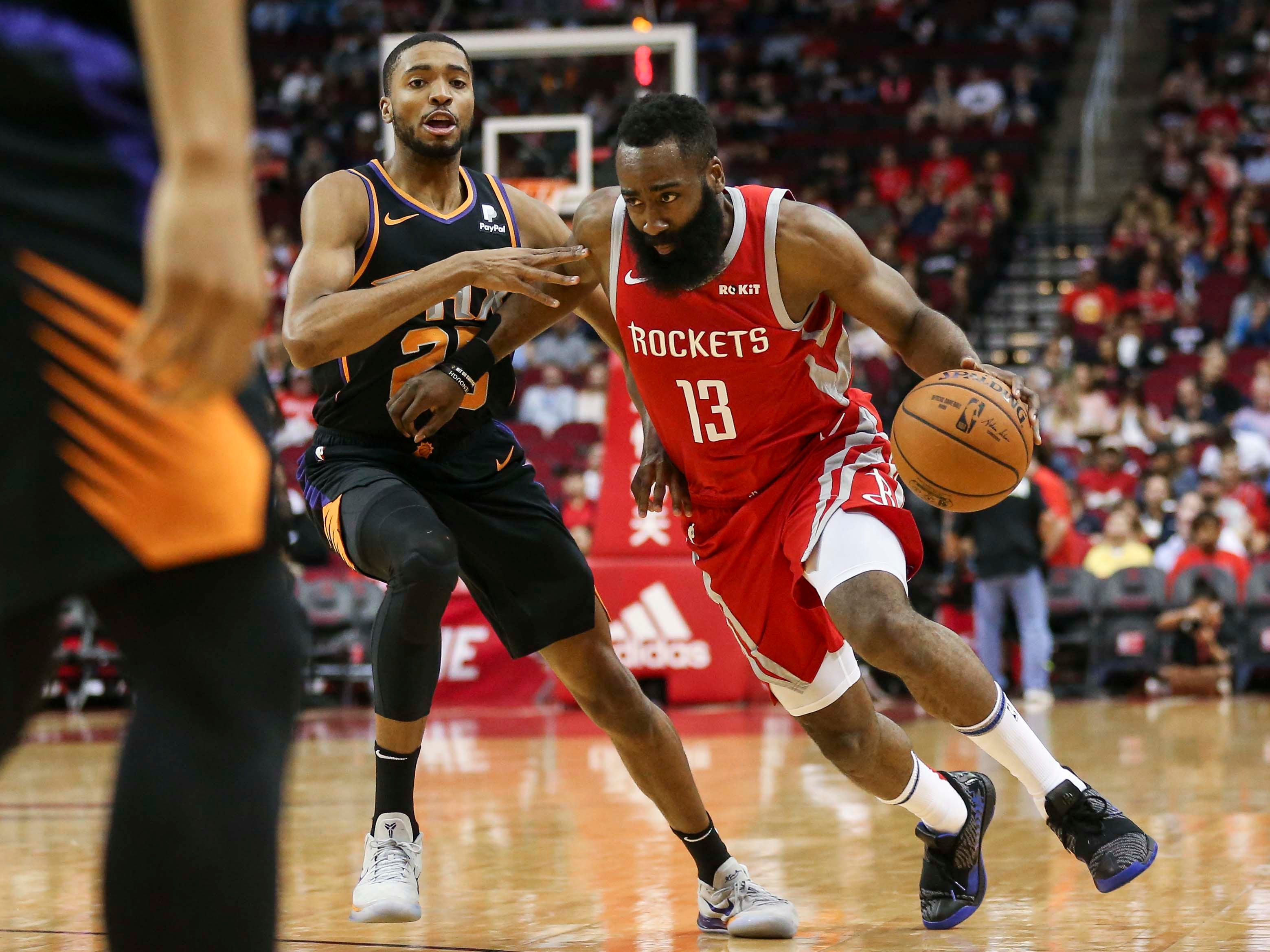 Apr 7, 2019; Houston, TX, USA; Houston Rockets guard James Harden (13) dribbles the ball as Phoenix Suns forward Mikal Bridges (25) defends during the first quarter at Toyota Center. Mandatory Credit: Troy Taormina-USA TODAY Sports