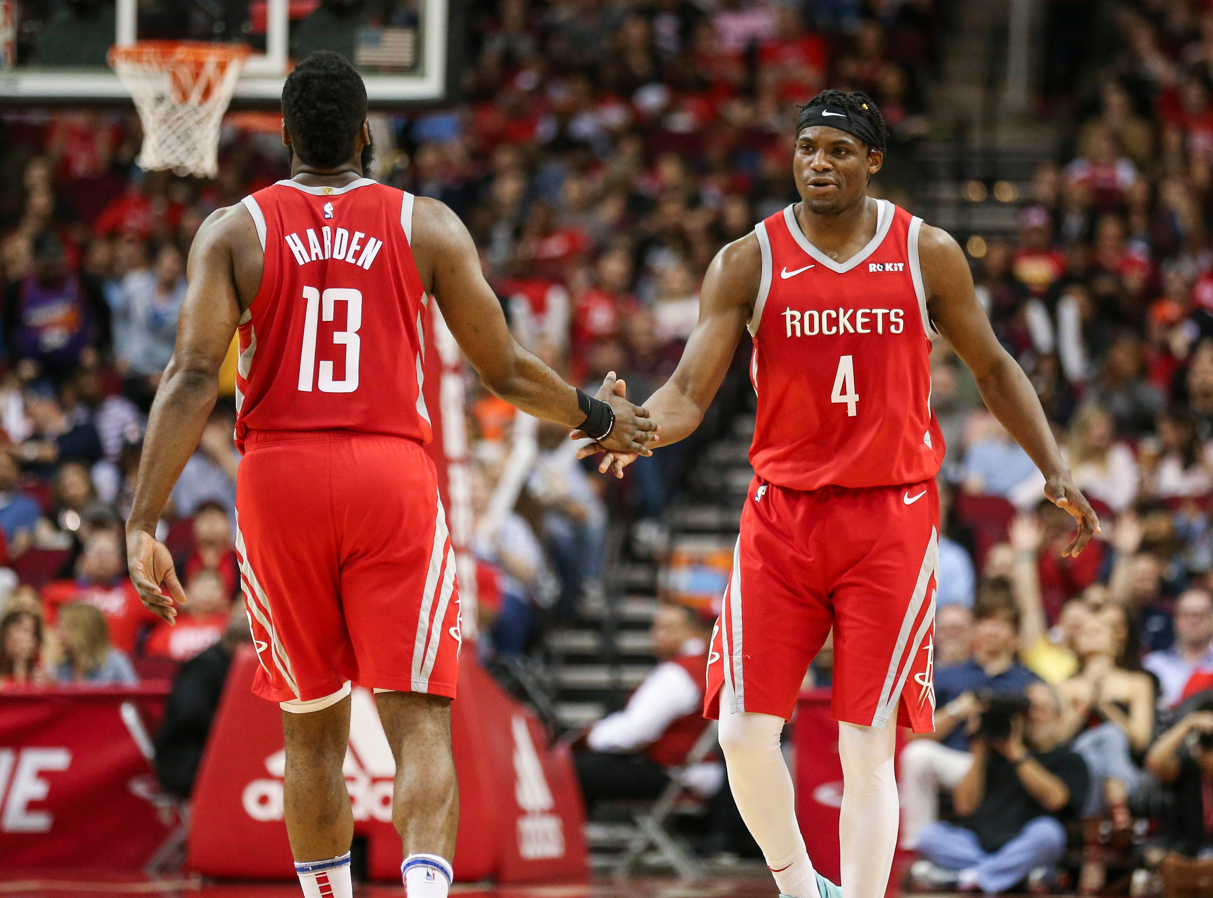 Apr 7, 2019; Houston, TX, USA; Houston Rockets forward Danuel House Jr. (4) celebrates with guard James Harden (13) after a play during the second quarter against the Phoenix Suns at Toyota Center. Mandatory Credit: Troy Taormina-USA TODAY Sports