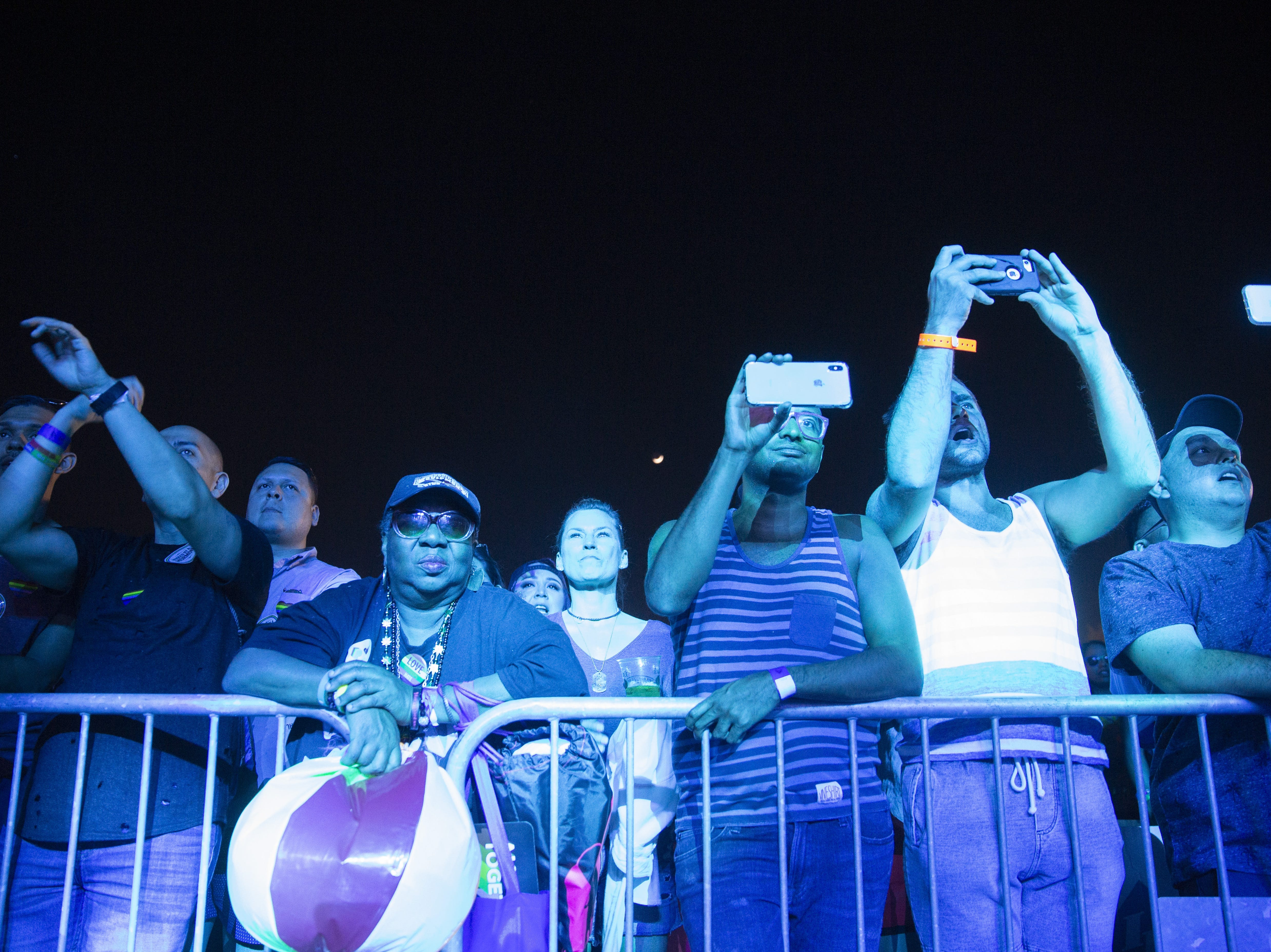 The crowd at the main stage films performers with their phones during Phoenix Pride at Steele Indian School Park on April 7, 2019.