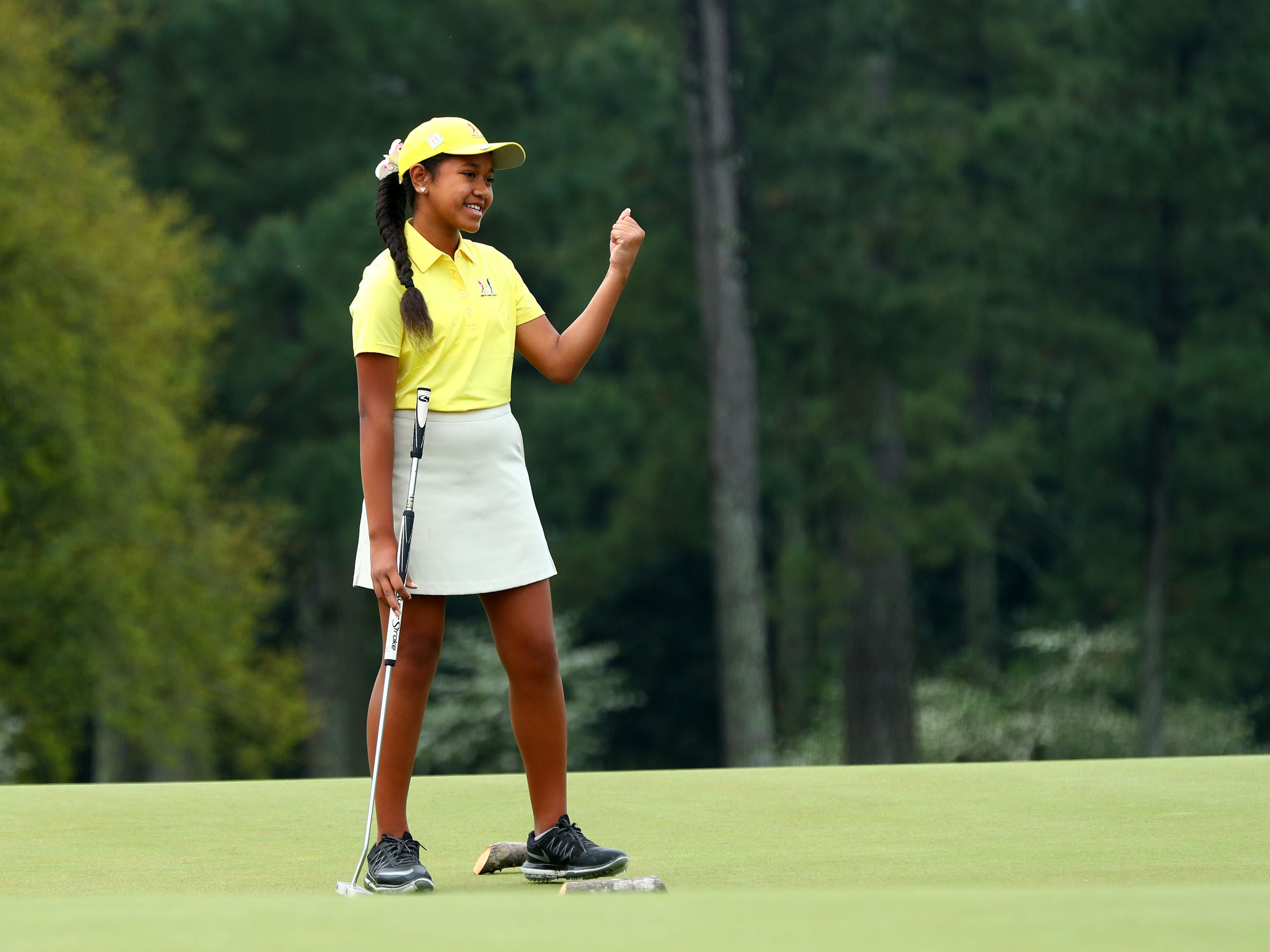 Apr 7, 2019: Alexis Vakasiuola of San Tan Valley, Ariz. in the girls 7-9 age group, reacts to her putt during the finals of the Drive, Chip and Putt competition at Augusta National Golf Club.