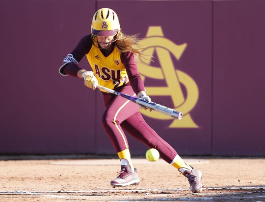 ASU's Kindra Hackbarth attempts to bunt against UCLA during the first inning at Farrington Stadium in Tempe, Ariz. April 7, 2019.