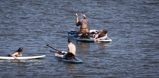 Paddleboarders enjoy the weather on April 8, 2019, at Tempe Town Lake.