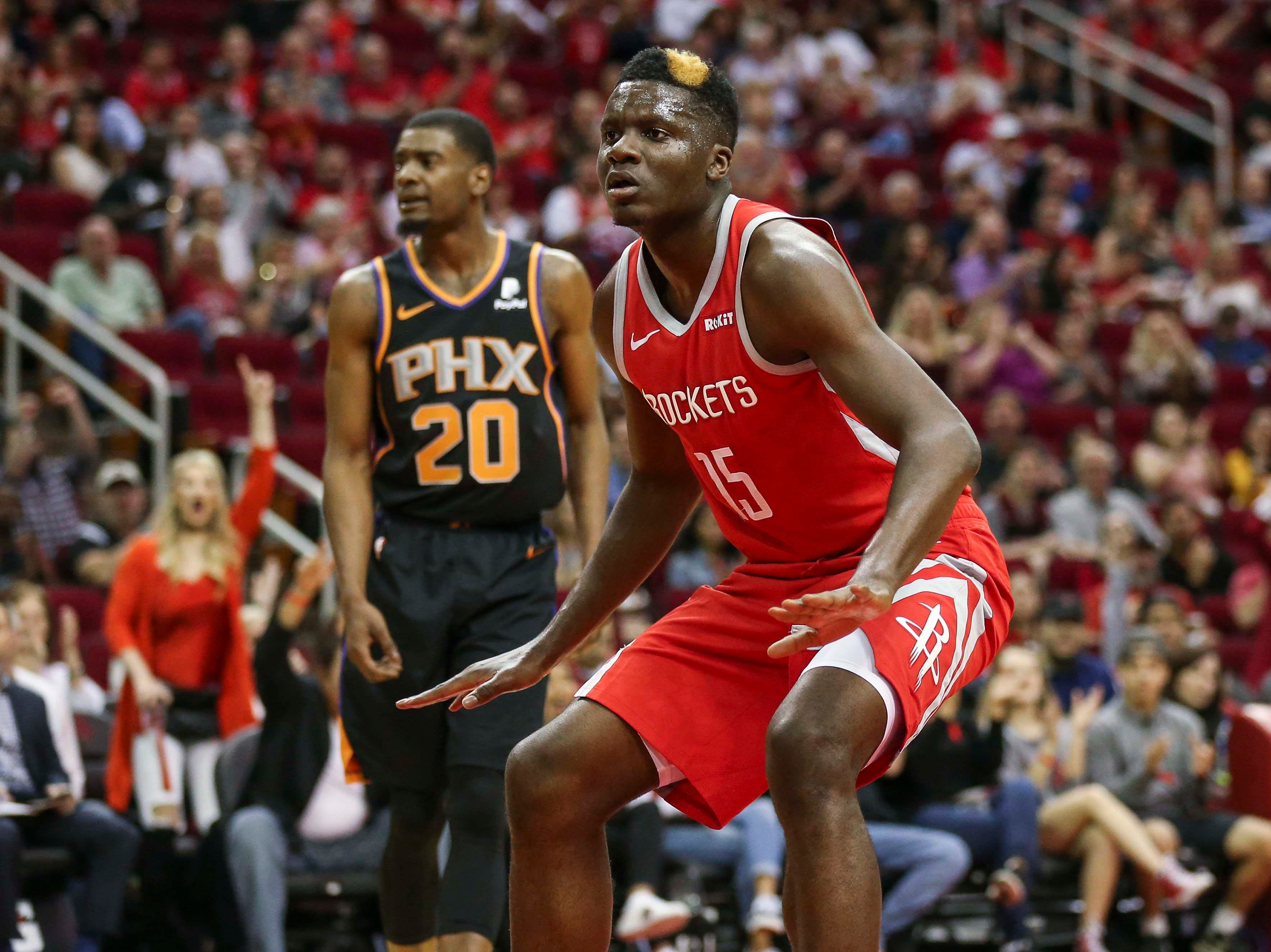 Apr 7, 2019; Houston, TX, USA; Houston Rockets center Clint Capela (15) and Phoenix Suns forward Josh Jackson (20) react after Capela scores a basket during the first quarter at Toyota Center. Mandatory Credit: Troy Taormina-USA TODAY Sports