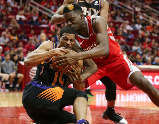 Apr 7, 2019; Houston, TX, USA; Phoenix Suns guard De'Anthony Melton (14) and Houston Rockets center Clint Capela (15) battle for the ball during the second quarter at Toyota Center. Mandatory Credit: Troy Taormina-USA TODAY Sports