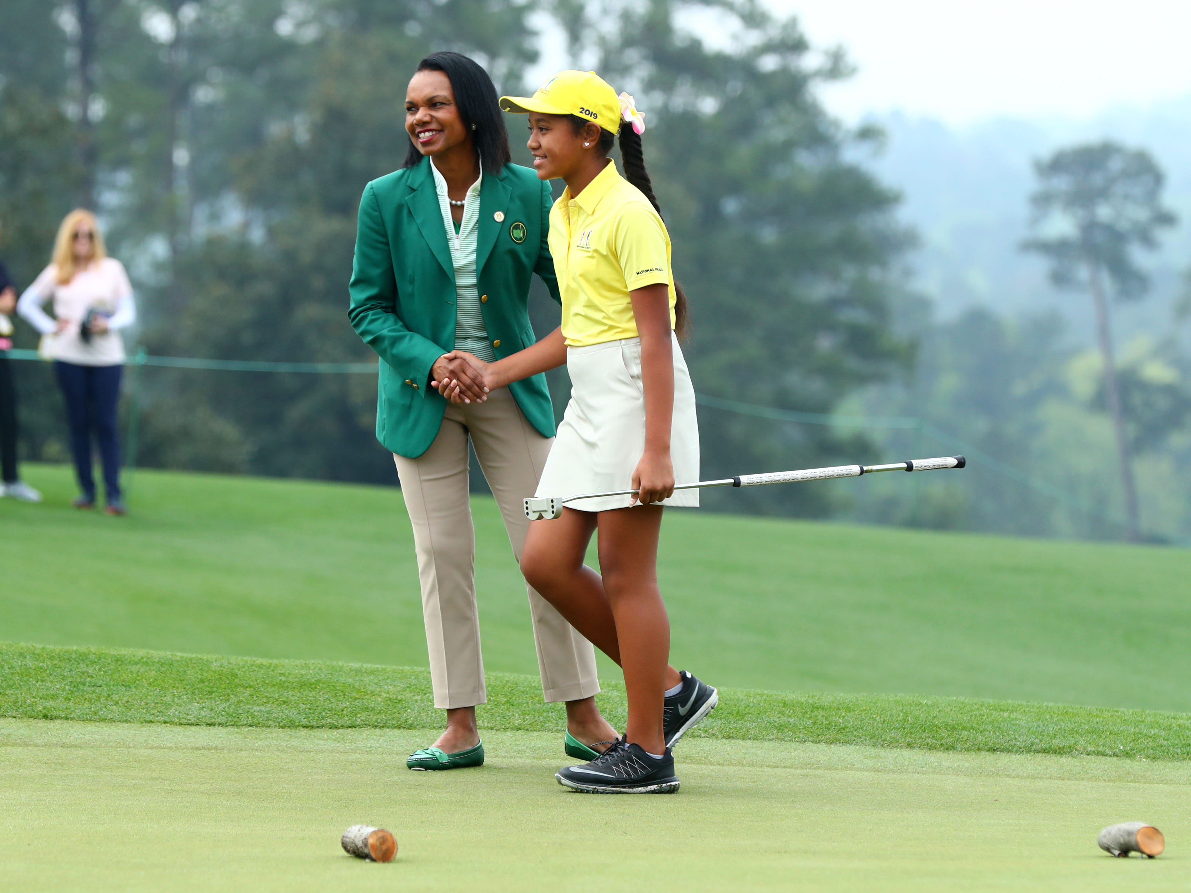 Apr 7, 2019: Augusta National member Condoleezza Rice congratulates Alexis Vakasiuola of San Tan Valley, Ariz. in the girls 7-9 age group during the finals of the Drive, Chip and Putt competition at Augusta National Golf Club.